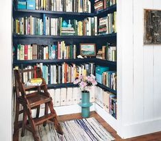 Dead closet space transformed into a hallway home library