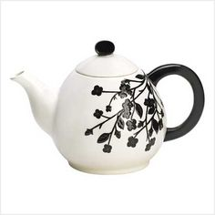 A Spray Of Jet Black Flowers Against Pure Snowy White Creates Striking Sight On This Tasteful Teapot