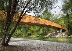 DANS Architects used timber planks and shingles to create this footbridge and cycle path, which connects a Slovenian village to nearby lakes and mountains