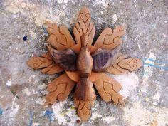 Divino e esplendor todo feito em madeira de demolição. Tamanho aproximado: 30 cm de diâmetro R$ 40,00