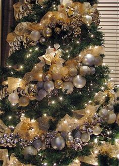 silver and gold christmas tree. garland christmas decor balls.
