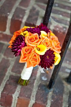 the-blushing-bride: orange and purple wedding... With white calla lilies instead of yellow, and blue.