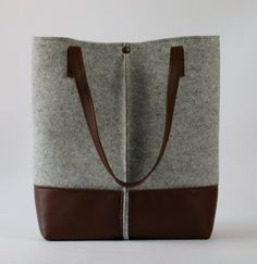 Express shipping All Around the world • Europe,24-48 hours • Other countries,48-62   ALL OF MY SHOPS BAG ARE CUSTOMIZABLE IN SIZE AND COLORS  this felt tote has a simple design but at the same time elegant . it made by high quality felt that is so soft to touch. The bag is large but lightweight, thanks of high quality felt.  Suitable for carrying everything in your everyday life.you can carry your books, magazines , laptop & ..... . as you can see in photo ,it has three inner pocket one b...