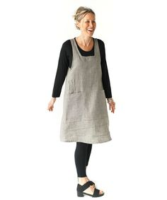 This is the dress you have been waiting for. A crisscross, vee back pinafore with two big pockets and chic pin tucks for a flattering shape. No buttons, no zippers ... slip it on and go. Wear it over