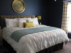 what about navy for the bedroom? with striped beige curtains.....we could do drop cloth curtains with a burlap band
