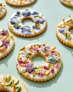 A buttery classic, sugar cookies make a delicious treat anytime. Here, Martha heightens them to special-occasion status with a simple glaze and a fanciful combination of candied flowers, crystallized ginger, and chopped pistachios. Flower Cupcakes, Flower Cookies, Cookie Bouquet, Sugar Cookies Recipe, Cookie Recipes, Martha Stewart Sugar Cookie Recipe, Elegant Cookies, Blossom Cookies, Edible Flowers