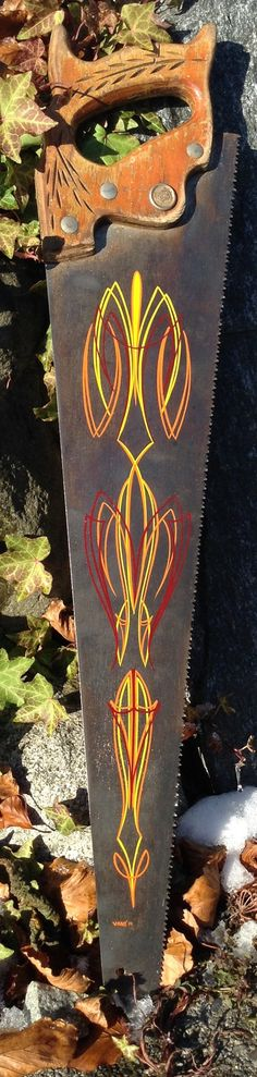 Vintage Saw with Pinstriping  $65. Pinstriped Vintage Saw