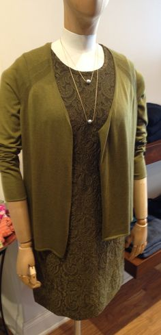 Isda's lace dress and sweater combo provide the perfect day-to-evening look in a shade of green that's actually really wearable.