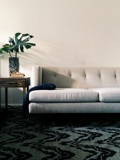 The pattern and texture on the rug really caught my eyes. I enjoy the lines on this couch but I need more pillows please :)
