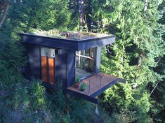 One of the most interesting waterfront properties and house designs we've seen. This tiny house by architect Peter Frazier is settled on the steep hill near Seattle, WA, and seems to be hanging in the air hardly attached to anything.