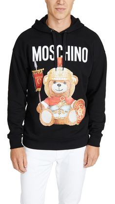 If you have access to the internet and a little cash to burn, there's never an excuse for a boring, outdated wardrobe. As we venture into the season a little… Mens Sweatshirts, Hoodies, Bear Graphic, The Fashionisto, Roman Soldiers, Versace Jeans Couture, Fashion Labels, Black Hoodie, Moschino
