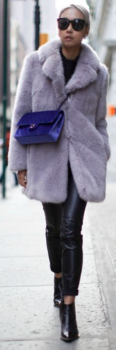 look effortlessly fashionable + keeping warm this fall + Vanessa Hong + velvet Chanel bag + leather pants + boots + bag matches perfectly with her fuzzy coat.  Bag: Chanel, Coat: Whistles, Pants: Zara, Earrings: Topshop, Boots: Sigerson Morrison
