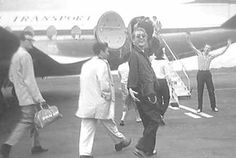 Buddy Holly, Paul Anka, and Jerry Lee Lewis boarding a plane