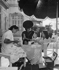 Cuban socialite Aline Johnson de Menocal and her friend Nina Gomez de Freyre receiving pedicures in Havana, Cuba, 1946.