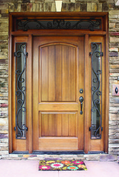 tan front door with forged sidelights