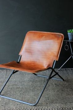 Pinning again because I LOVE this Leather Folding Chair, $199.30 - ships from UK for $77