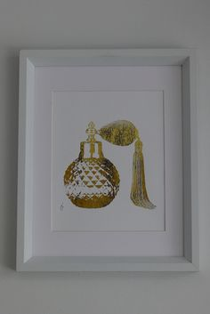 For the hallway, trio of frames with the Chanel bottle, the Dior and this (Vintage Perfume Bottle 24K Gold. $20.00, via Etsy.)