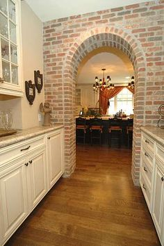 Butler Pantry...we could do a wall  like this! So much added character! Could use stone instead of brick...