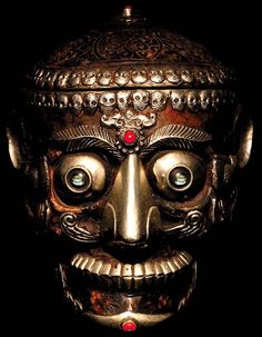 Cult of Weird  Kapala, a carved human skull from Napal decorated in semi precious stones and used in Buddhist rituals to hold ceremonial offertory liquids