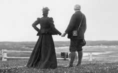 Gilbert H. Grosvenor • Alexander Graham Bell and his wife Mabel hold hands at the water's edge in Nova Scotia in 1898