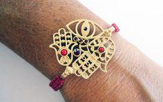 Hamsa Evil Eye Hand of Fatima Bracelet Gold Plated Red Stones Handmade Red Macrame. $9.99, via Etsy.