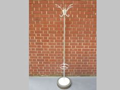 1970's Belgian Coat Stand in brushed chrome with a heavy metal base inset with a white plastic tray to catch the rainwater from the umbrellas. A very cool retro piece perfect for your hallway.