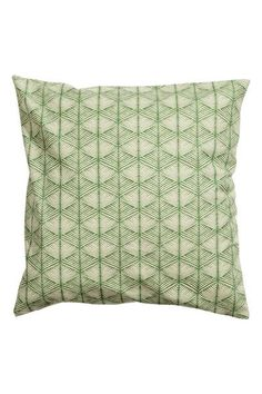Cushion cover in cotton canvas with an all-over print on the front, solid colour back and concealed zip.