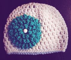Crocheted 6-12 months old hat with flower detail