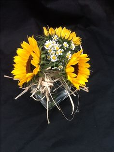Simple sunflower and raffia vase table centre #weddingflowers