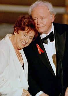 In remembrance: Actress Jean rested her head on the shoulder of All in the Family co-star Carroll O'Connor at the 48th Annual Emmy Awards in 1996.