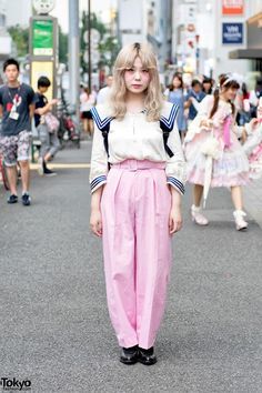 Rio's sailor collar top is by L'ecole Des Femmes worn with pink belted Virginis pants and Comme Des Garcons shoes. Her backpack is by Cheap Monday.