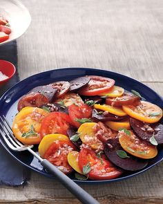 Beet and Tomato Salad -Slices of roasted beets and fresh beefsteak tomatoes are dressed with shallot vinaigrette and fresh oregano to create a colorful and flavorful salad