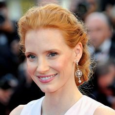 Jessica Chastain wears earrings from the Louis Vuitton Les Ardentes collection at Cannes Film Festival