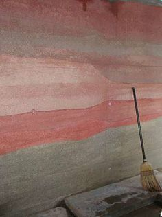 """""""Rammed earth is one of the most labor intensive earthen construction processes of all because of the combination of heavy form erection, wall pounding, and the mixing and moving of large volumes of earth. But it's also one of the most beautiful looking due to it's sandstone-like appearance and large wall thicknesses."""""""