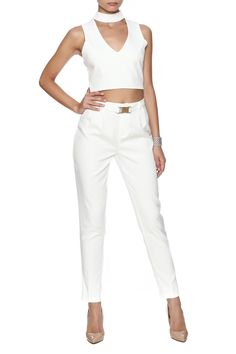 White pant suit: crop top with cut outs and exposed zipper closure; bottom with buckle closure in front.   White Pant Suit by Next Boutique . Clothing - Matching Sets New York New York City
