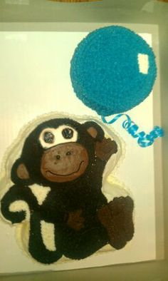 monkey with a blue balloon
