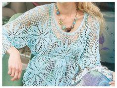 Lindisímo color aguamarina , un remerón con moivos circulares que se unen dando forma a la prenda siendo suelta y elegante