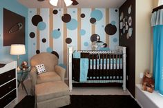 i love the paint job on the accent wall and the color palette. It is another good idea for a nursery.