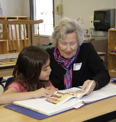 Resident volunteer reading to student at Two Rock Element School through United Way Schools of Hope