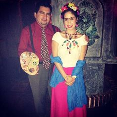 Looking for a couple's costume idea? This real girl has Frida down pact with a cream peasant blouse, long skirt, and colorful accouterments — but what really makes her costume complete is her companion, decked out as Frida's longtime lover, painter Diego Rivera. Guys looking to get in on the costume fun can copy this look with a shirt and tie in muted colors, plus a painter's palette and brush.