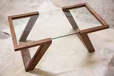 The Evans Coffee Table is the cornerstone of our Evans Collection. Hand made from solid Black Walnut, the table is finished with 5 hand-rubbed Ver como se mete el cristal en la madera Wooden Furniture, Cool Furniture, Furniture Design, Luxury Furniture, Furniture Dolly, Table Furniture, Furniture Ideas, Glass Furniture, Furniture Buyers