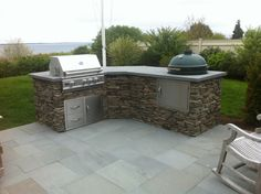 Inspiration Kitchen. Posh Outside Kitchen For Styles, Layouts And Decorations: Charming Stack Stones Panelling Stainless Steel Built In Gas Barbecue Grill As Decoration Outside Kitchen Without Awning Inspiring Ideas