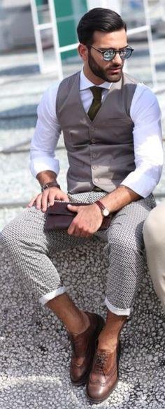 Sunglasses, Vest, Trousers, Oxfords, Waist Coats, @ Pitti Uomo. Photo Lee Oliveira via The New York Times. Men's Spring Summer Fashion.