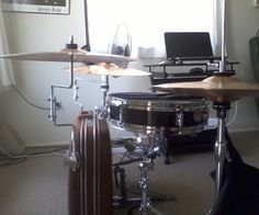 Floor tom leg mounts and rod cymbal holders attach cymbals