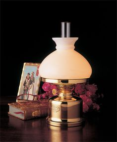 A reproduction of an 1800-1900 Danish oil lamp with a 34 hour burn time.