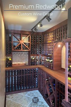 A garage partially converted into a custom wine cellar. A tasting area with a hanging glassware rack rests beneath a bulk storage area. Wine Cellar Racks, Wine Rack, Storage Area, Wine Storage, Cooling Unit, Wine Cellar Design, Wine Collection, Walnut Stain, Design Consultant