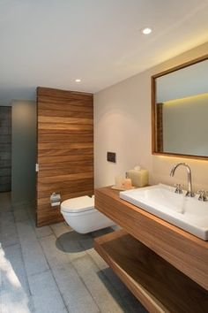 i like the wood shelf below sink for towels or pool users clothes, etc. Backlit mirror is nice - but not yellow. Concrete floor would be good for the guest and pool users bathroom