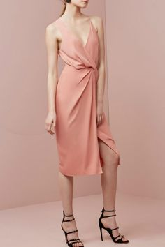 This midi dress in dusty rose, is fully lined with a mid weight drape fabric. It features a twist front detail at waist with a wrap over skirt, semi open back with drape detail. It has an asymmetric 'V' neck line and an invisible zip at centre back. Would be perfect paired with black or nude heels.   Without You Dress by Keepsake. Clothing - Dresses - Wrap Dress Clothing - Dresses - Wedding Wear Clothing - Dresses - Midi Clothing - Dresses - Cocktail Victoria, Australia