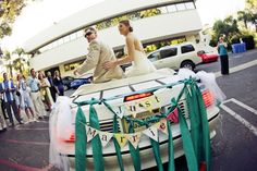 Colorful DIY San Luis Obispo Wedding Awwwe love the get away car decor!
