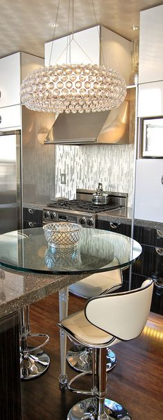 kitchen - love the round glass counter on the end